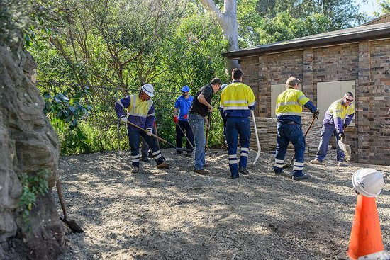 Spreading road-base for under the pavers.