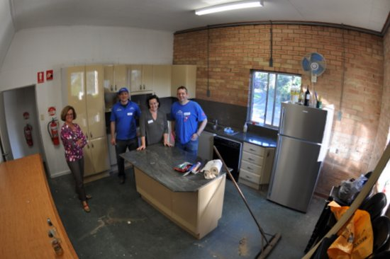 Part of the team enjoying a few well-earned beers. Kitchen looks fantastic after a new coat of paint.