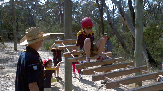 Max on the low ropes course at Ingleside with Russell, Ray and Siobhan watching.